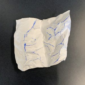 Ridges of the crumpled paper traced with a blue marker