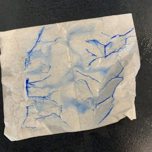 Paper sprayed with water demonstrates effects of rainwater